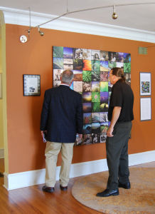 Mayor Buddy Dyer admiring Giving Circle Gallery art piece