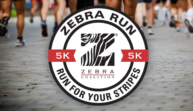 Zebra Run badge