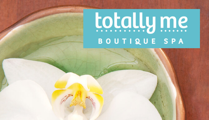 Totally Me Boutique Spa logo and flower